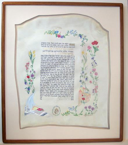 Ketubah framed in a hand-finished wood frame & hand cut/wrapped fabric mat